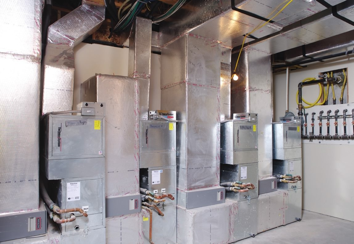 basement of a large custom home many unico air handlers in basement of